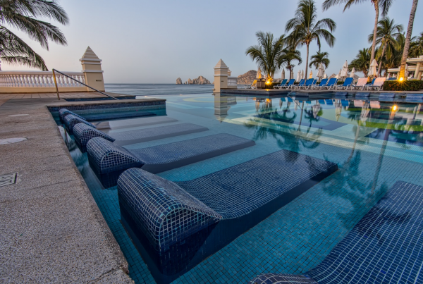 Resort pool with tiled chairs.